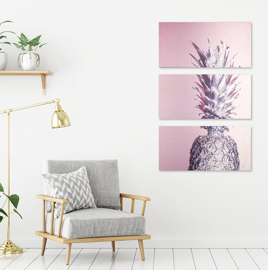 metal print in living room of pink and silver pineapple