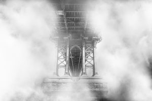 black and white bridge in mist