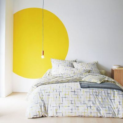 bedroom with yellow circle painted on wall