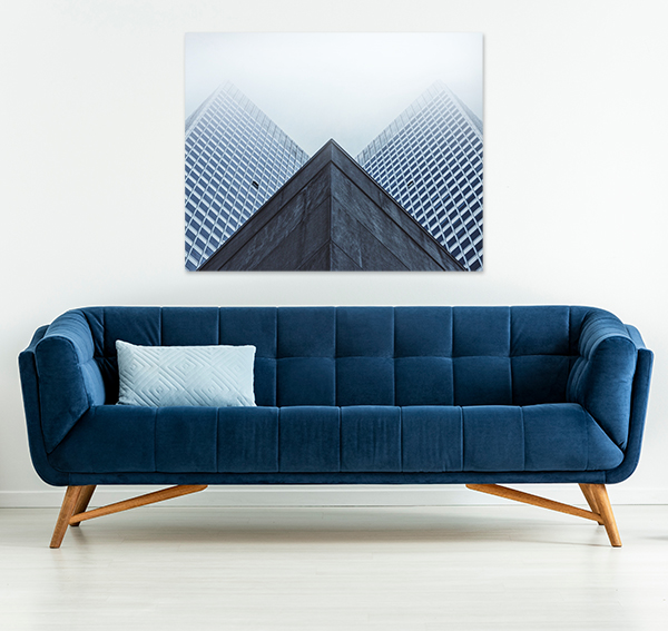 photo patrick tomasso architecture canvas print above blue couch