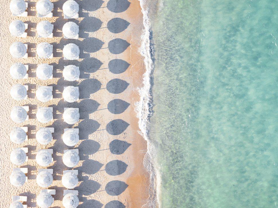 white umbrellas beach